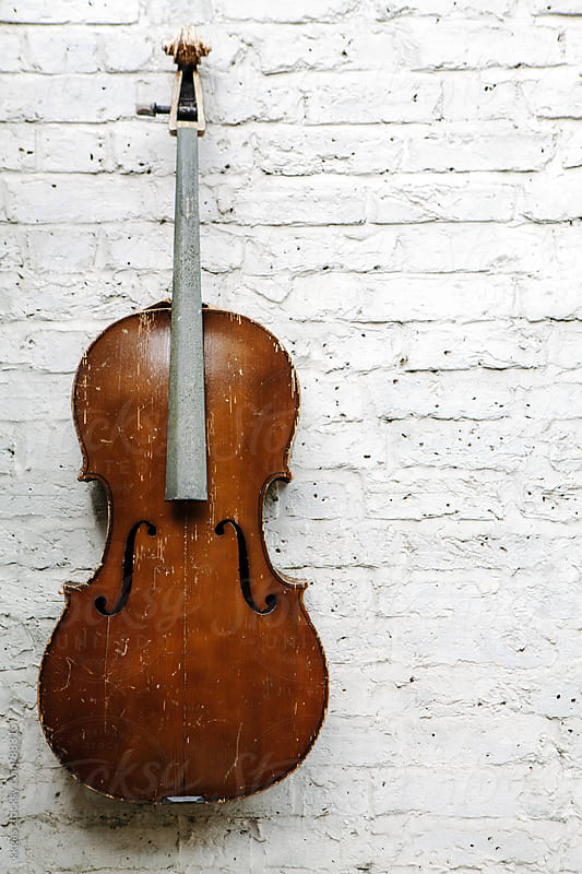 Old weathered cello against a textured white wall  by kkgas for Stocksy United