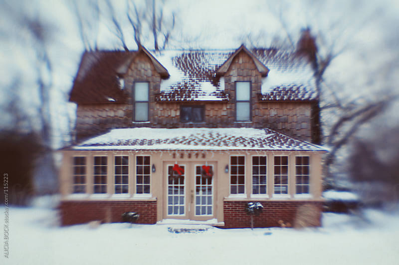 A Charming Home Decorated For The Holidays and Covered In Fresh Snow by ALICIA BOCK for Stocksy United