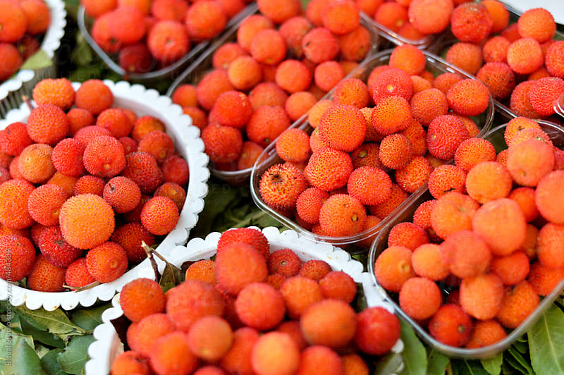 Arbutus berries on a market by Bisual Studio for Stocksy United