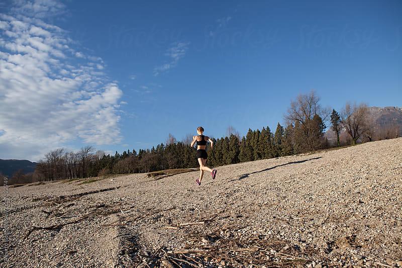 Girl runs along the beach by Alberto Bogo for Stocksy United