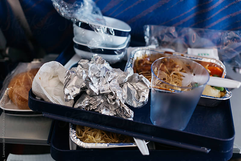 Leftover airplane meal by Lawrence del Mundo for Stocksy United