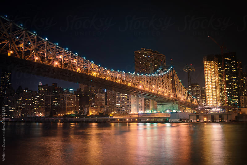 59th Street Bridge and New York City Skyline at Night by Vivienne Gucwa for Stocksy United