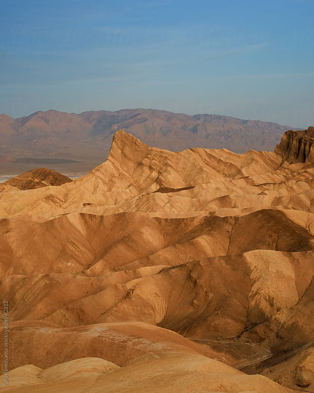 Zabriskie Point in Death Valley National Park at sunrise by Tara Romasanta for Stocksy United