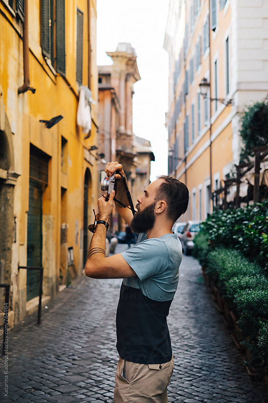 Bearded Male Tourist Taking Photos With His Camera by Katarina Radovic for Stocksy United