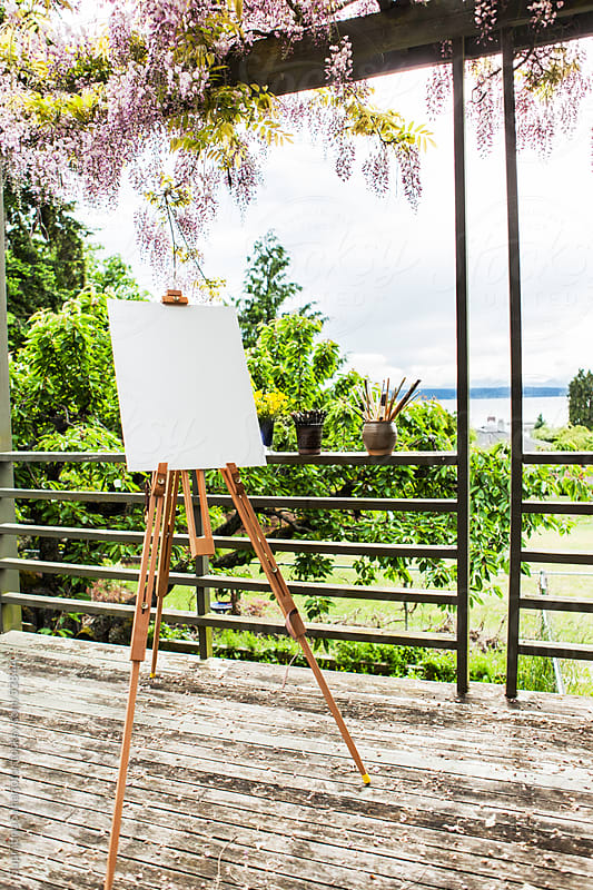 Blank canvas on easel ready to be painted on by Suprijono Suharjoto for Stocksy United