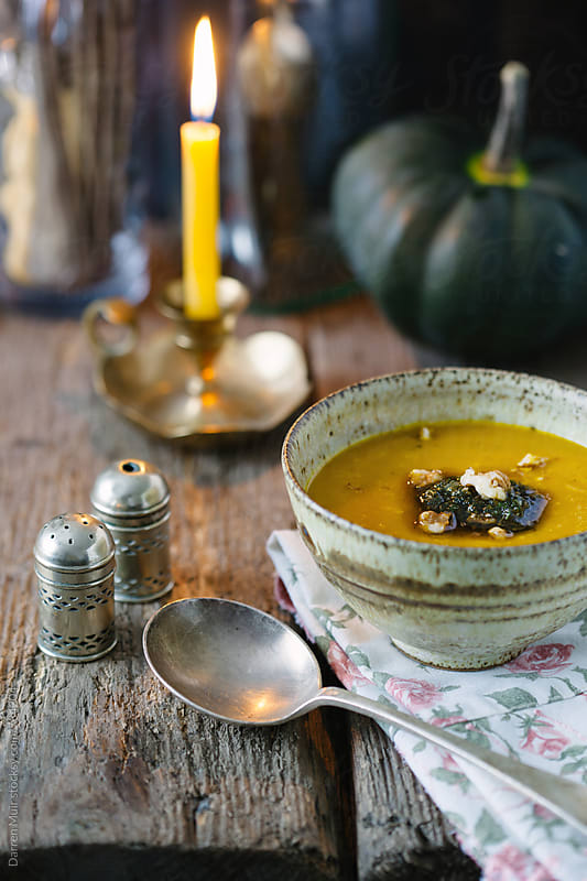 Pumpkin soup. Pumpkin soup in a bowl in a rustic background. by Darren Muir for Stocksy United