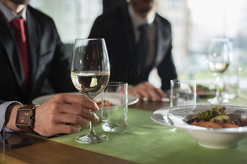 Businessmen at a Restaurant by Lumina for Stocksy United