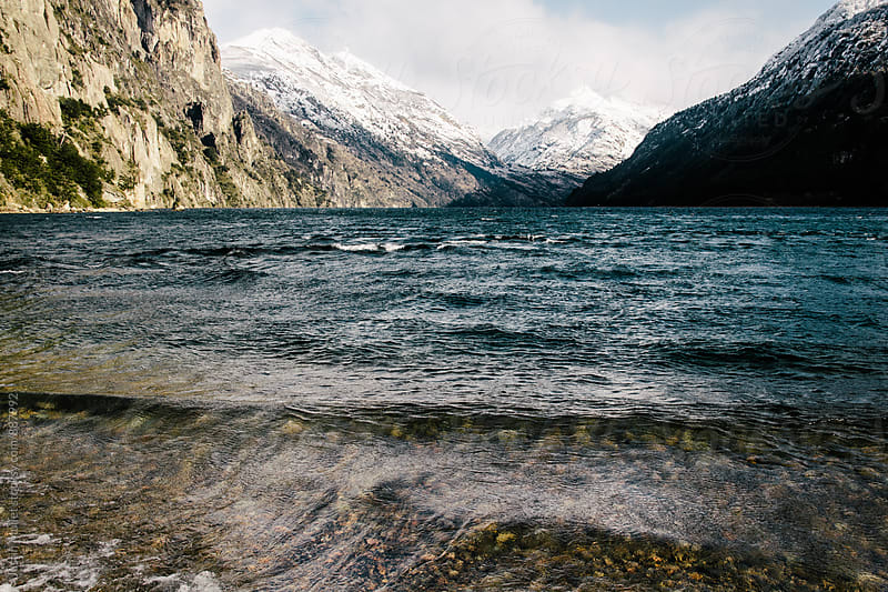 Small waves on a remote mountain lake.  by Justin Mullet for Stocksy United
