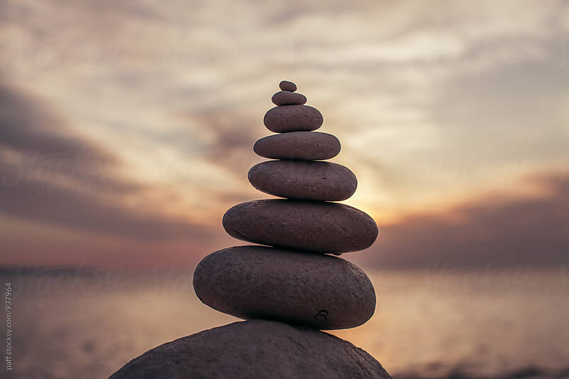 Stacked rocks at the beach overlooking the ocean by paff for Stocksy United