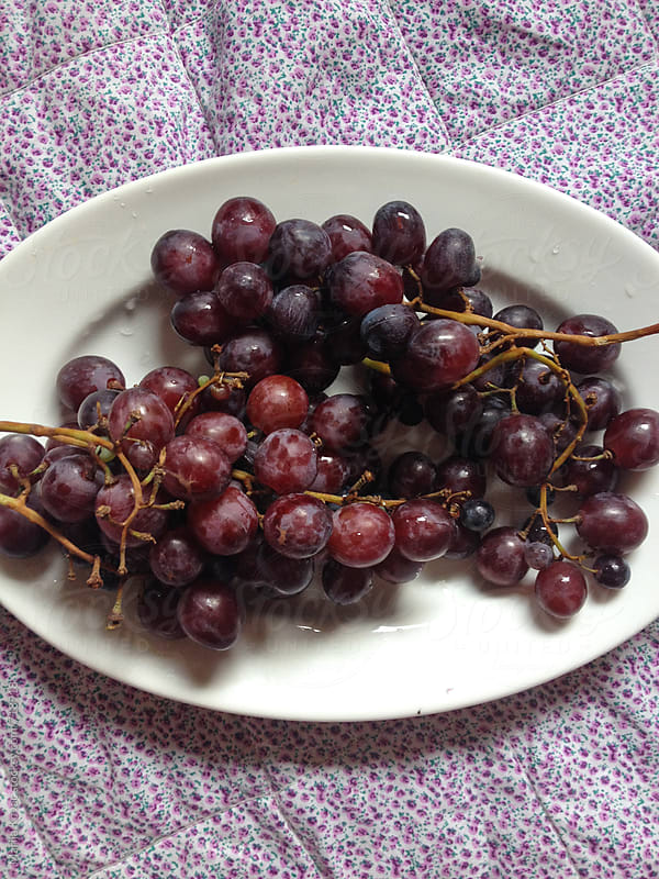 Fresh grapes in a bowl by Marija Kovac for Stocksy United
