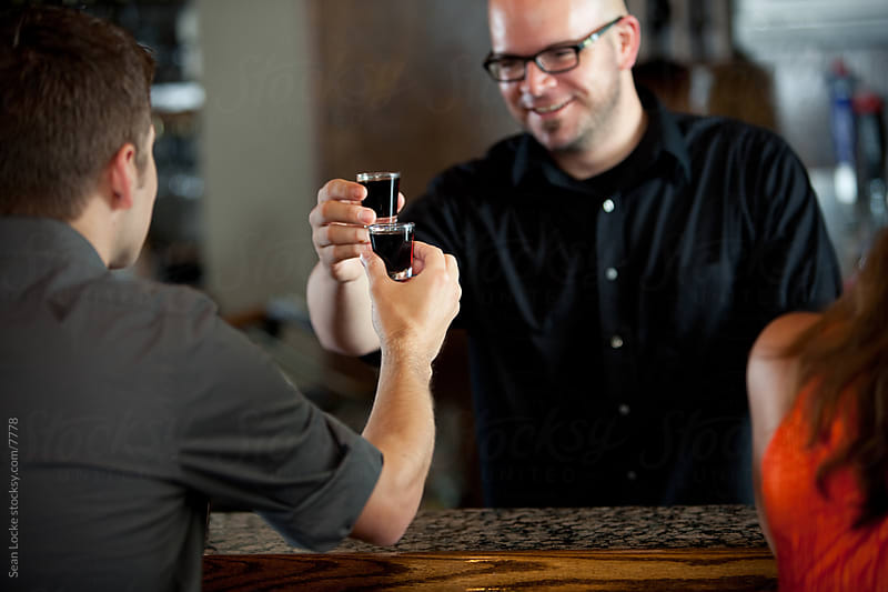 Bar: Bartender Sharing Shot with Customer by Sean Locke for Stocksy United
