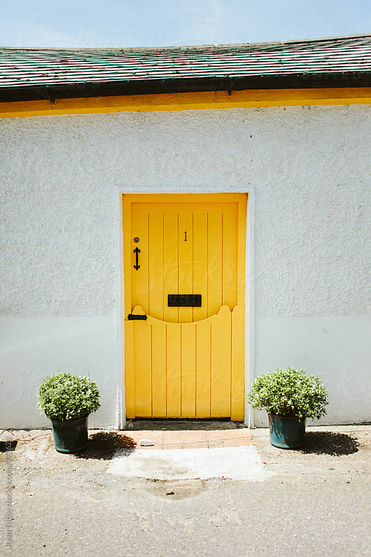 Yellow Door #1 by Ryan Tuttle for Stocksy United