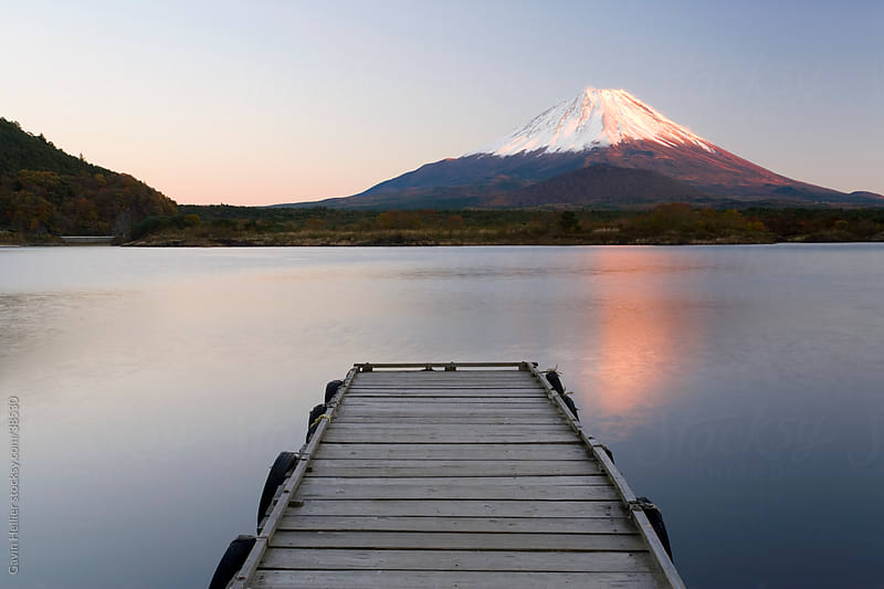 Japan, Central Honshu (Chubu), Fuji-Hakone-Izu National Park, Mount Fuji (3776m) snow capped and viewed across lake Shoji-ko in the Fuji Go-ko (five lakes) region by Gavin Hellier for Stocksy United