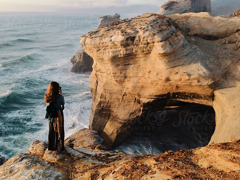 Woman on Edge of Coastline by Kevin Russ for Stocksy United