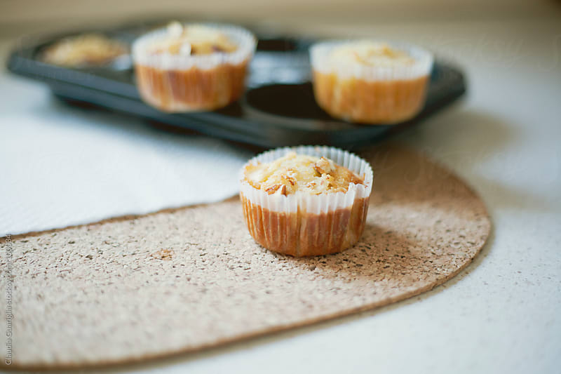 Almond and apples muffins by Claudia Guariglia for Stocksy United