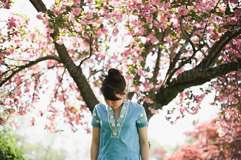 Young woman with spring cherry blossoms by Joe St.Pierre Photography for Stocksy United