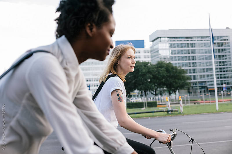 Two Female Commuters on Bicycles by VegterFoto for Stocksy United