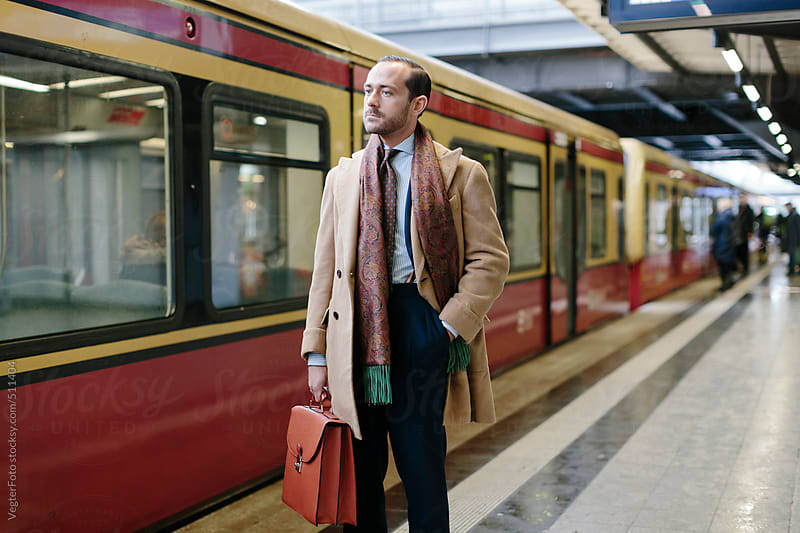 Businessman With Briefcase At Train Station Platform by VegterFoto for Stocksy United