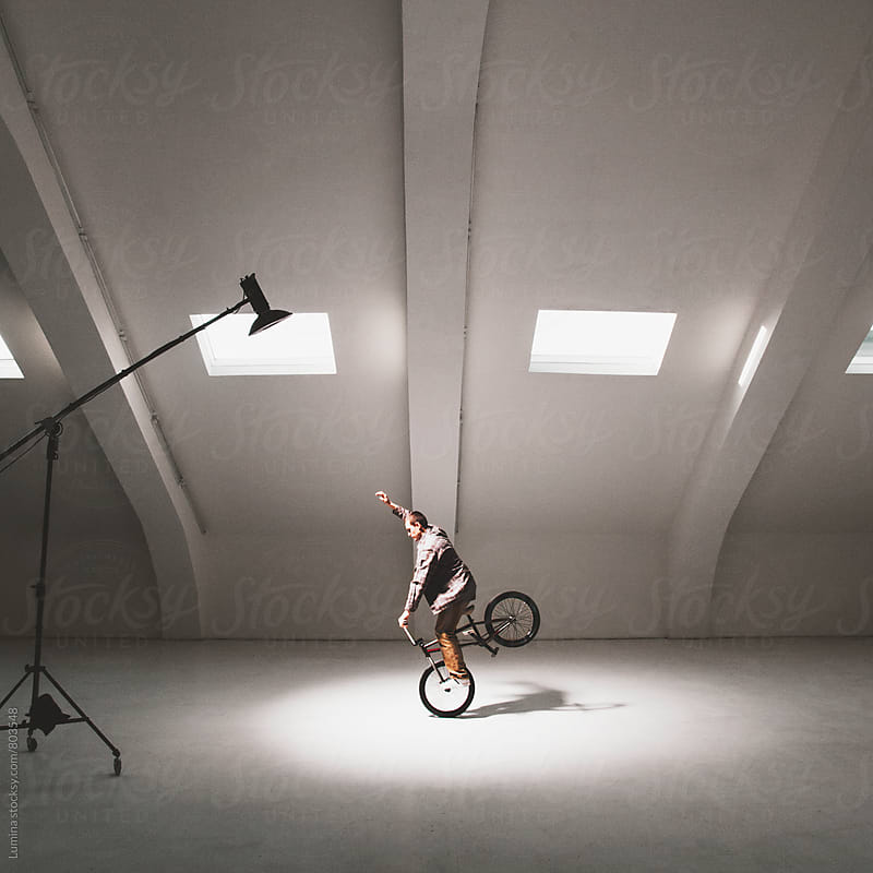 Man Performing on His BMX Bike Flatland Style by Lumina for Stocksy United