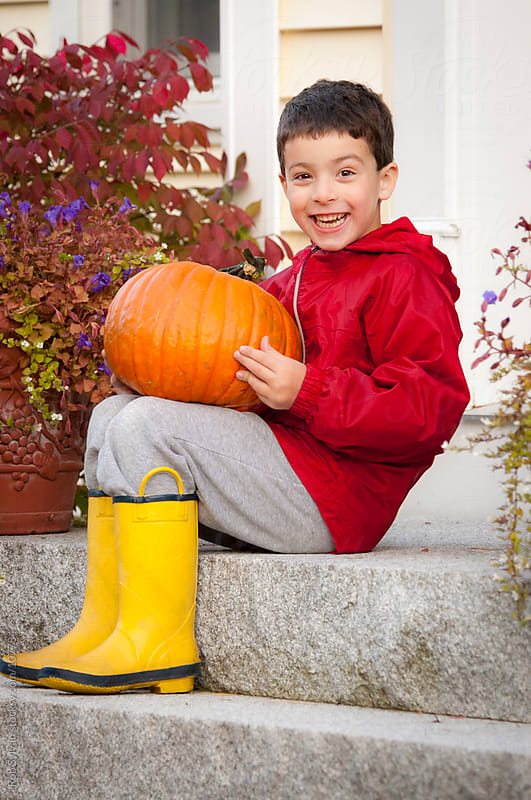 Little Boy with Pumpkin by Rob Sylvan for Stocksy United