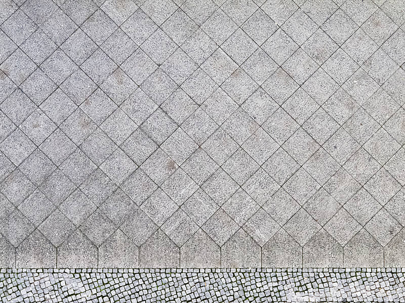 Sidewalk tiles photographed from above by Melanie Kintz for Stocksy United