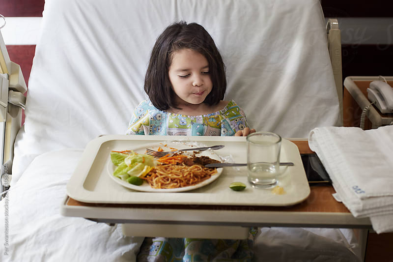 Little sick girl refusing to eat her food by Per Swantesson for Stocksy United