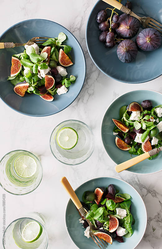 Healthy salad: Fig and goats cheese salad bowls. by Darren Muir for Stocksy United
