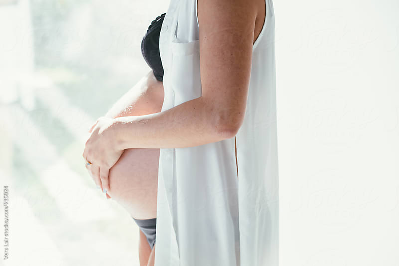 Pregnant woman       by Vera Lair for Stocksy United