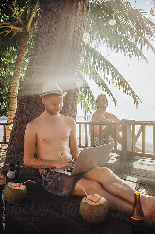 Man With a Laptop Computer Chilling at the Beach by Lumina for Stocksy United