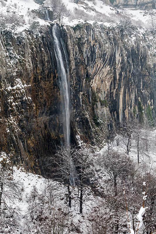 Cascade in wintertime by Marilar Irastorza for Stocksy United