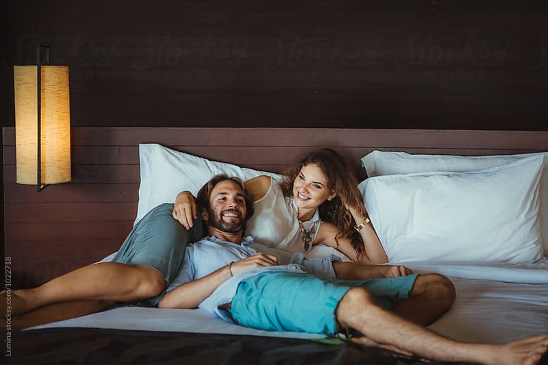 Happy Couple Relaxing in a Hotel Room by Lumina for Stocksy United