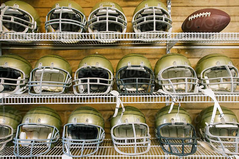 Football Helmets on Shelf by Raymond Forbes LLC for Stocksy United