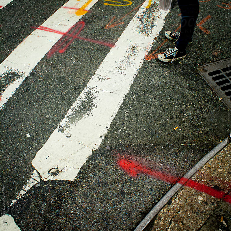 Shoes and crosswalk by Juanjo Grau for Stocksy United
