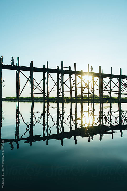 Setting Sun Behind Wooden Bridge on High Stils by VISUALSPECTRUM for Stocksy United