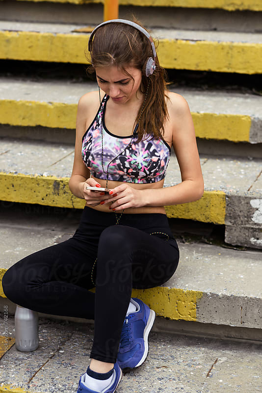 Sporty woman resting during workout by Milles Studio for Stocksy United