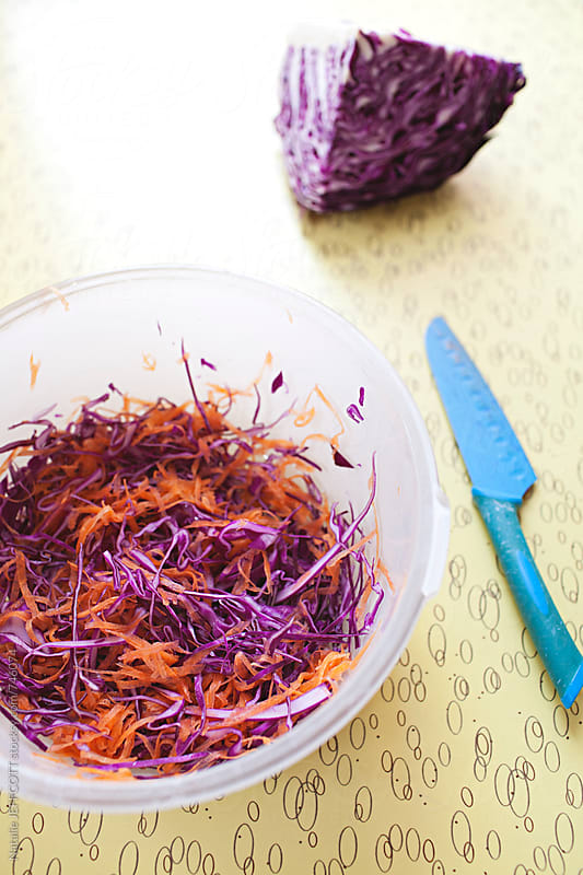 Making coleslaw with red cabbage, carrot and yoghurt by Natalie JEFFCOTT for Stocksy United