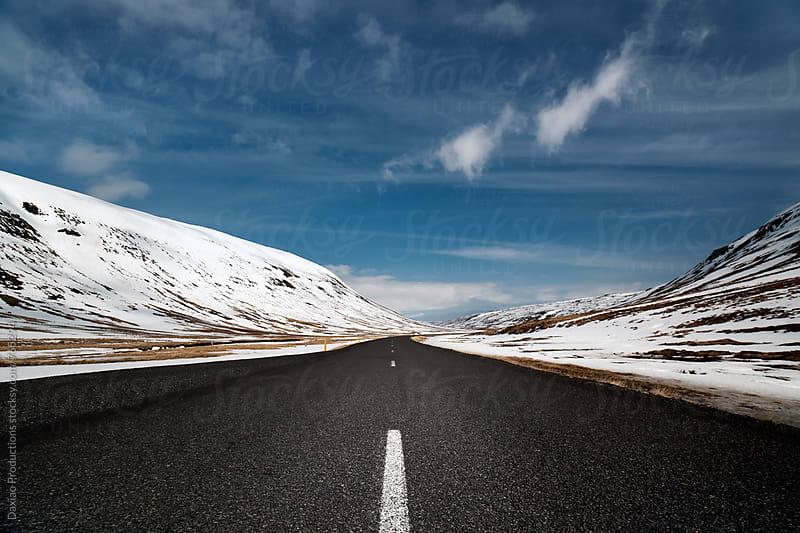 Empty road in snow landscape by Daxiao Productions for Stocksy United