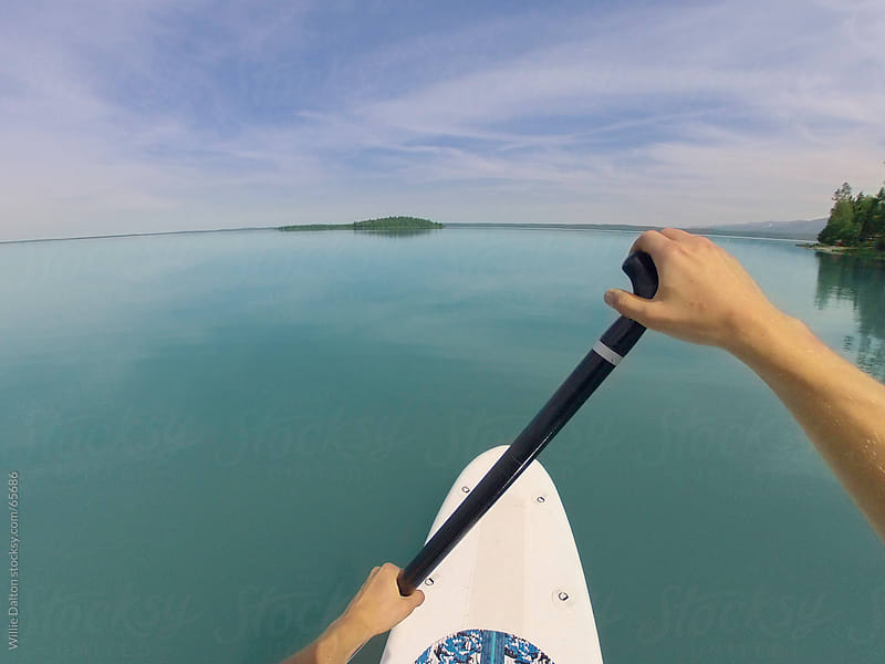 Point of View of a Stand Up Paddle Boarder by Willie Dalton for Stocksy United