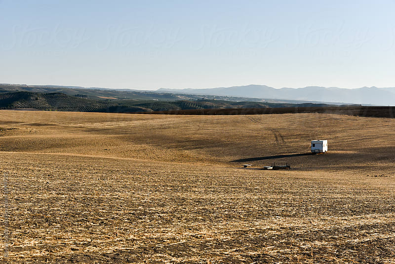 Solitary caravan in a dry and warm meadow by Bisual Studio for Stocksy United