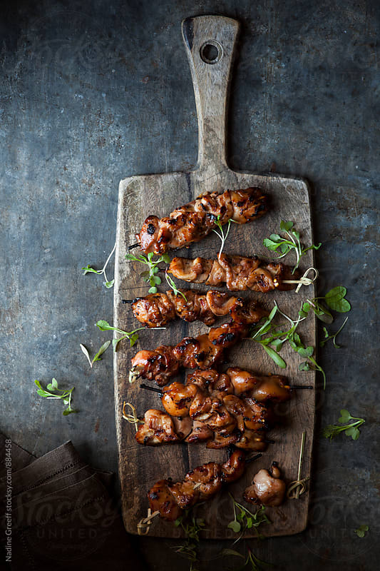 BBQ chicken breast on skewers with micro greens by Nadine Greeff for Stocksy United