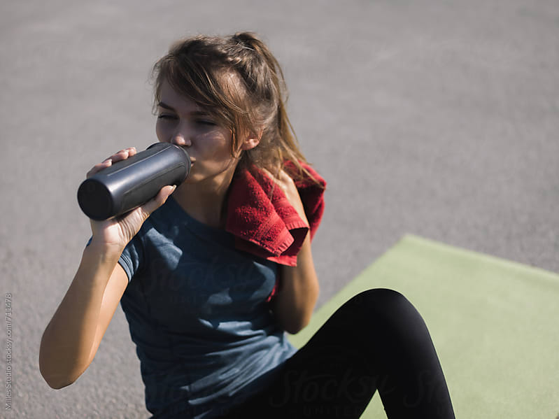 Woman resting from workout by Milles Studio for Stocksy United