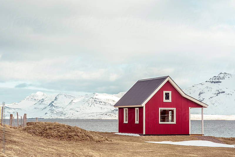 Traditional Icelandic house by the sea and mountains in winter by Soren Egeberg for Stocksy United