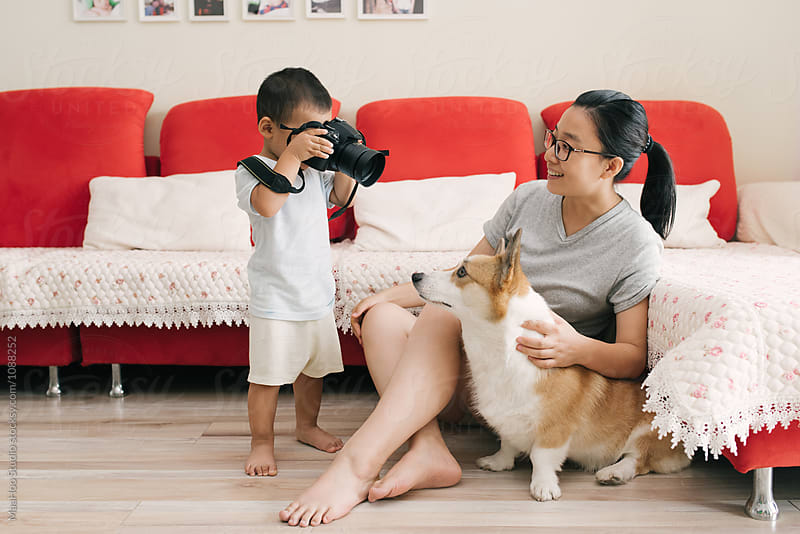 Adorable toddler boy take photos for his mother at home by MaaHoo Studio for Stocksy United