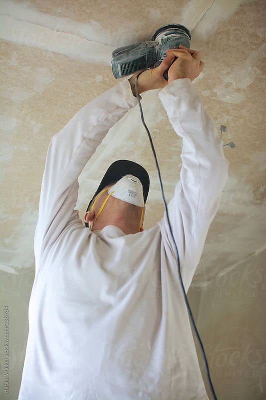 Sanding a ceiling by Harald Walker for Stocksy United