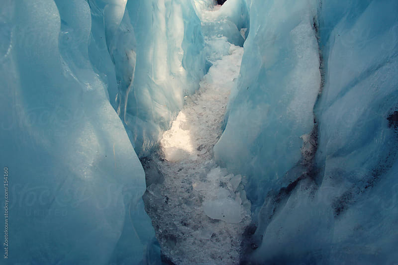 Sunlight coming through an ice crevice of Franz Josef Glacier, New Zealand by Kaat Zoetekouw for Stocksy United
