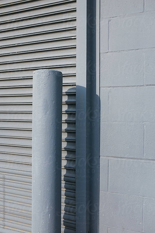 Metal pole and building exterior by Paul Edmondson for Stocksy United
