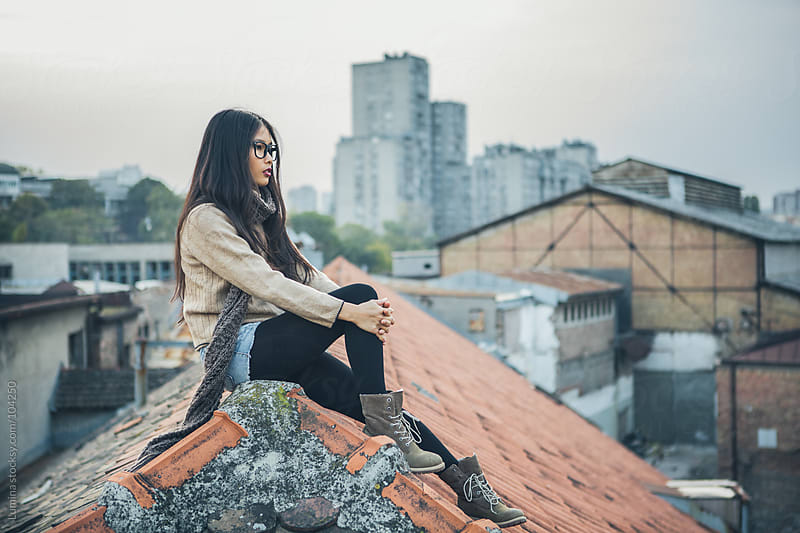 Woman Sitting on the Rooftop by Lumina for Stocksy United