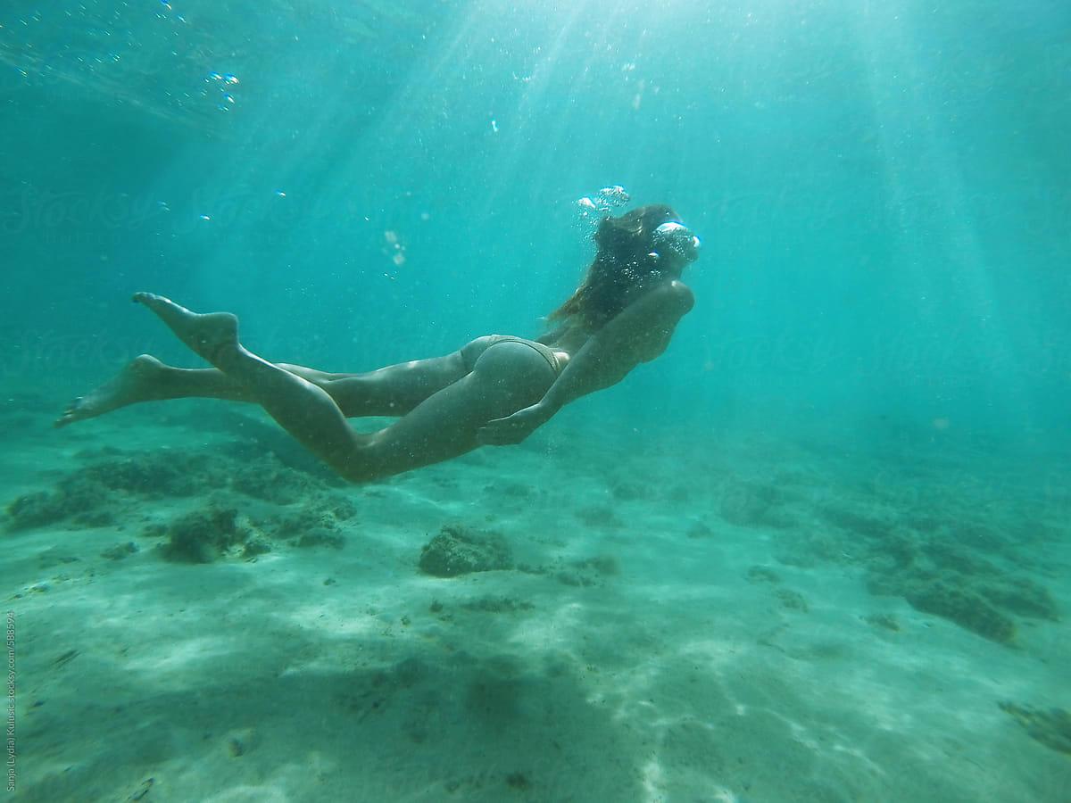 Skinny Fit Girl Swimming Underwater  Stocksy United-9915