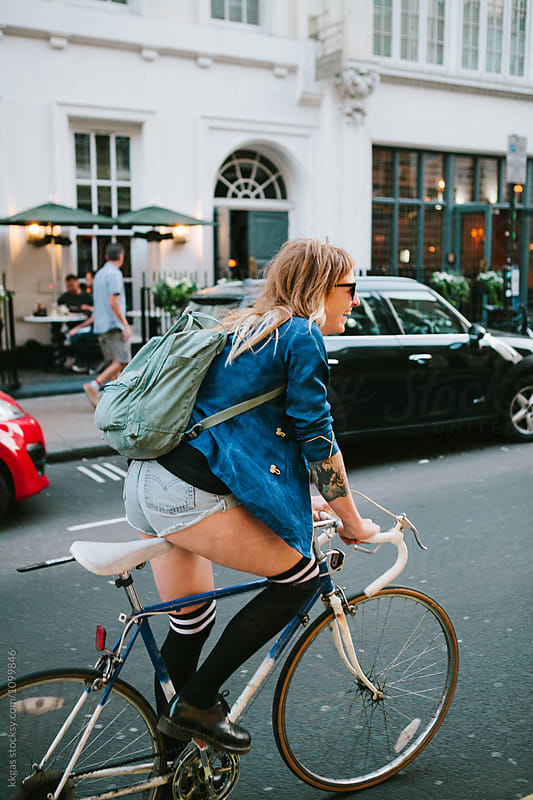 Attractive woman riding a bicycle in london by kkgas for Stocksy United
