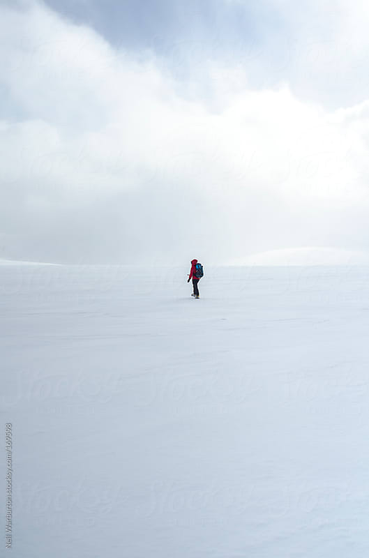 Lone Hiker on Summit Plateau by Neil Warburton for Stocksy United